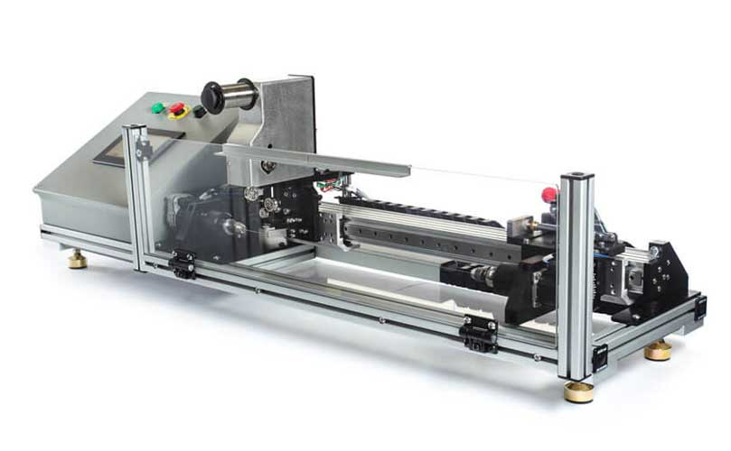 Image shows Engineering By Design's Benchtop Winder which includes servo tension option slide